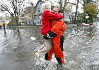 Senior Being Carried By Rescue Worker After Hurricane Sandy