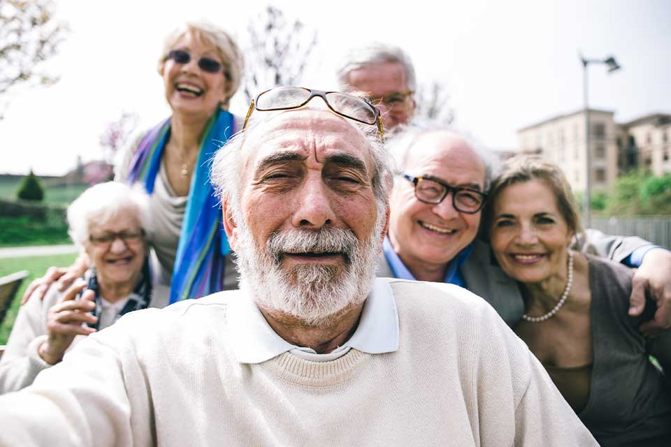 Large family of elder siblings finding agreement on senior care options for their father with the help of a mediator.