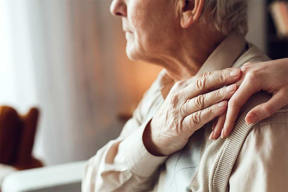 Elderly couple struggling to cope with dementia behaviors.