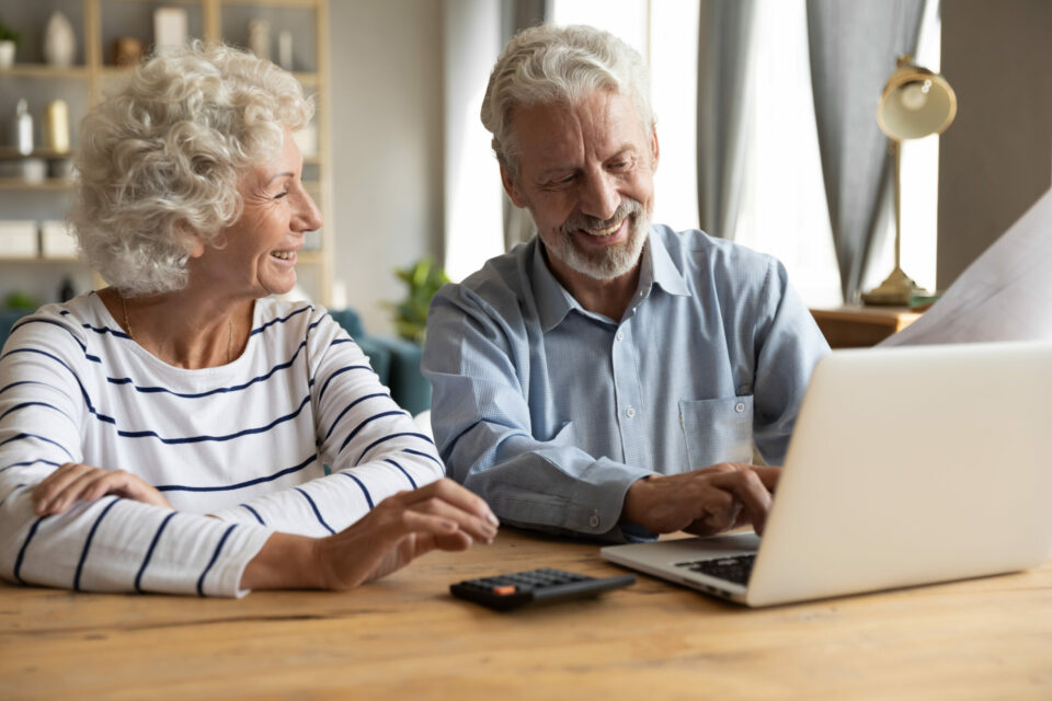 Couple collaborating to calculate cost of assisted living near them.