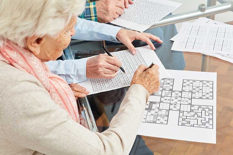 Elderly dementia patients completing memory activities.