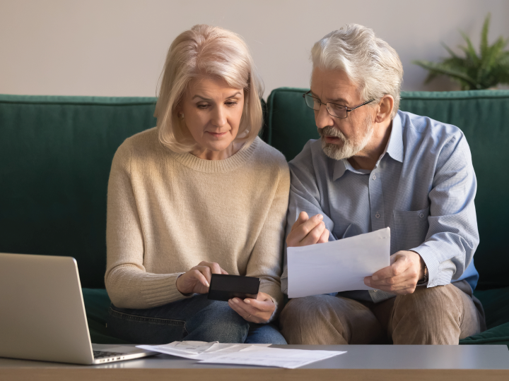 Elderly couple discussing documents
